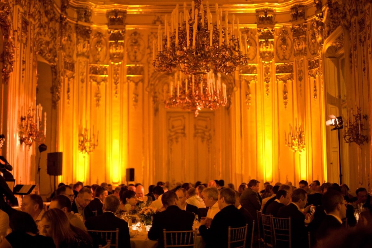 Round tables with guests in the Big Ballroom of the Wenckheim Mansion in Budapest